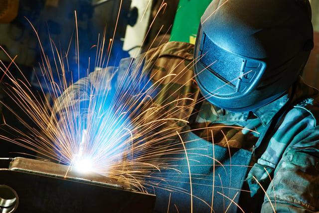 bigstock-welder-working-with-electrode--62894980.jpg